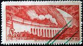 CHINA - CIRCA 1952: A stamp printed in china shows passenger train with steam locomotive on the railroad viaduct Chungking-Chengtu, circa 1952 — Stock Photo