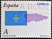 SPAIN - CIRCA 2009: A stamp printed in spain shows flag and map of the autonomous community of Asturias, circa 2009 — Stock Photo