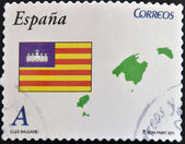 SPAIN - CIRCA 2011: A stamp printed in spain shows flag and map of the autonomous community of balearic islands, circa 2011 — Stock Photo