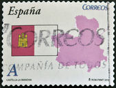 SPAIN - CIRCA 2010: A stamp printed in spain shows flag and map of the autonomous community of Castilla La Mancha, circa 2010 — Stock Photo