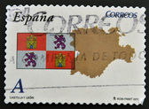 SPAIN - CIRCA 2011: A stamp printed in spain shows flag and map of the autonomous community of Castilla y Leon, circa 2011 — Stok fotoğraf