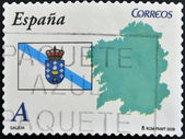SPAIN - CIRCA 2009: A stamp printed in spain shows flag and map of the autonomous community of Galicia, circa 2009 — Foto de Stock