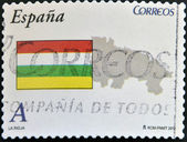 SPAIN - CIRCA 2010: A stamp printed in spain shows flag and map of the autonomous community of La Rioja, circa 2010 — Stock Photo