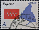 SPAIN - CIRCA 2011: A stamp printed in spain shows flag and map of the autonomous community of Madrid, circa 2011 — Stock Photo