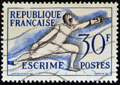 FRANCE - CIRCA 1953: A stamp printed in France devoted to fencing, circa 1953 — Stock Photo