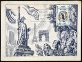 FRANCE - CIRCA 1960: A stamp printed in France dedicated to international year of the refugee, shows open hands to welcome the refugees in usa and europe, circa 1960 — Stock Photo