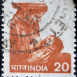 INDIA - CIRCA 1984: A stamp printed in India shows woman breast-feeds the baby, circa 1984 - Stock Photo