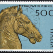 ITALY - CIRCA 1988: A stamp printed in Italy dedicated to Pergola bronze, shows horse head, circa 1988 - Stock fotografie