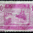 Royalty-Free Stock Photo: MAURITANIA - CIRCA 1922: stamp printed by Mauritania shows Bedouins and animals, circa 1922