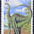 NEW ZEALAND - CIRCA 2004: A stamp printed in New Zealand shows image of a Sauropod, circa 2004 — Foto de Stock