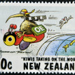 Stock Photo: NEW ZEALAND - CIRC1997: stamp printed in New Zealand shows humorous design kiwis taking of world, circ1997