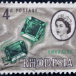 RHODESIA - CIRCA 1964: A stamp printed in Rhodesia shows emeralds, circa 1964 — Stock Photo