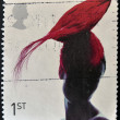 Stock Photo: UNITED KINGDOM - CIRC2001: stamp printed in Great Britain dedicated to fabulous hats, shows Toque Hat by Pip Hackett, circ2001