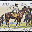 Stock Photo: REPUBLIC OF SOUTH AFRIC- CIRC1984: stamp printed in Transkei shows horseman, circ1984
