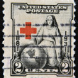 Stock Photo: UNITED STATES OF AMERIC- CIRC1931: stamp printed in USshows young of Red Cross, noting globe, circ1931