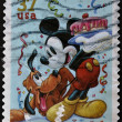Stock Photo: UNITED STATES - CIRC2005: stamp printed in USshows cartoon, Disney Characters, Pluto, Mickey Mouse, circ2005