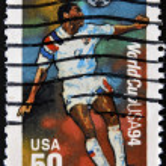 USA - CIRCA 1994:A post stamp printed in USA shows football player, devoted football world championship,USA, circa 1994. — Stock Photo #9451823