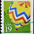 Stock Photo: UNITED STATES OF AMERICA - CIRCA 2000: A stamp printed in USA shows Hot Air Balloon yellow, circa 2000