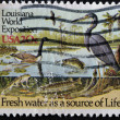 Stock Photo: US- CIRC1984: stamp dedicated to 1984 LouisianWorld Exposition shows fresh water as source of life, circ1984.