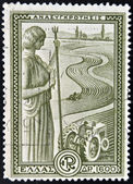 GREECE - CIRCA 1970: A stamp printed in Greece shows statue of Ceres overlooking an agricultural field, circa 1970 — Stock Photo