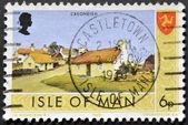 ISLE OF MAN - CIRCA 1973: A stamp printed in Isle of Man shows Cregneish, circa 1973 — Stock Photo