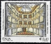 ITALY - CIRCA 2002: A stamp printed in Italy shows theater of concord en Monte Castello di Vibio, Perugia, circa 2002 — Stock Photo