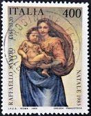 ITALY - CIRCA 1983: A stamp printed in Italy shows the Virgin and Child by Raphael Sanzio, circa 1983 — Stock Photo