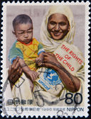 JAPAN - CIRCA 1996: A stamp printed in japan shows Unicef mother and child, circa 1996 — Zdjęcie stockowe