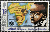 JERSEY - CIRCA 2011: A stamp printed in Jersey dedicated to 50th anniversary united nations children´s fund, shows a boy and a map of africa, circa 2011 — Stock Photo