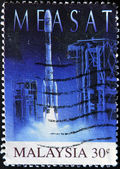 MALAYSIA - CIRCA 1996: A stamp printed in Malaysia shows Measat (First Malaysia Satellite Launched), circa 1996 — Stock Photo