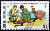 MALDIVE ISLANDS CIRCA 1973: stamp printed by Malldive Islands, shows boy scouts Lifesaving, circa 1973 — Stock Photo