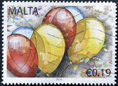 MALTA - CIRCA 2010: A stamp printed in alta shows ballons, circa 2010 — Foto de Stock