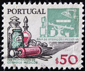 PORTUGAL - CIRCA 1970: A stamp printed in Portugal shows medical instruments and modern operating room, circa 1970 — Foto Stock