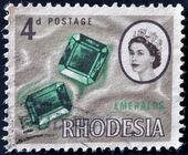RHODESIA - CIRCA 1964: A stamp printed in Rhodesia shows emeralds, circa 1964 — Stock Photo