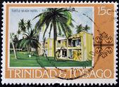 TRINIDAD AND TOBAGO - CIRCA 1970: A stamp printed in Trinidad and Tobago shows turtle beach hotel, circa 1970 — Stock Photo