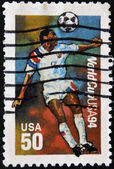 USA - CIRCA 1994:A post stamp printed in USA shows football player, devoted football world championship,USA, circa 1994. — Stock Photo