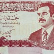 IRAQ - CIRCA 2000 : banknote 5 dinar Iraq , showing the image of deposed leader Saddam Hussain, circa 2000 — Stock Photo