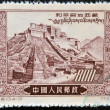 CHINA - CIRCA 1952: A stamp printed in China dedicated to &quot;peaceful liberation of Tibet&quot; shows panoramic views of the Potala Palace in Tibet, circa 1952 - Stock Photo