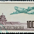 CHINA - CIRCA 1951: A stamp printed in China shows plane flying over the imperial city, circa 1951 — Stock Photo #9850800