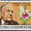 CUBA - CIRCA 1989: A stamp printed in CUBA dedicated to Latin American history, shows a Cochleanthes discolor and Alejo Carpentier, circa 1989 — Stock Photo