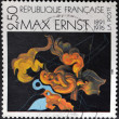 Постер, плакат: FRANCE CIRCA 1991: A stamp printed in France shows the work After we Motherhood by Max Ernst circa 1991