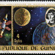 GUINEA CIRCA 1973: stamp printed by Guinea, dedicated to the anniversary of Nicolas Copernicus shows Earth, moon and spacecraft, circa 1973 — Stock Photo