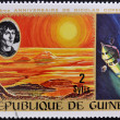 GUINECIRC1973: stamp printed by Guinea, dedicated to anniversary of Nicolas Copernicus shows Sunrise and spacecraft, circ1973 — Stock Photo #9851157