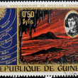 GUINECIRC1973: stamp printed by Guinea, dedicated to anniversary of Nicolas Copernicus shows Primeval Landscape, circ1973 — Stock Photo #9851173