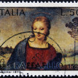ITALY - CIRCA 1970: A stamp printed in Italy shows painting of the Virgin Mary by Raffaello, circa 1970 — Stock Photo