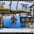 Stock Photo: MEXICO - CIRC1997: stamp printed in Mexico shows sailboats and buildings at resort town of Valle de Bravo in Estado de Mexico,circ1997