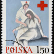POLAND - CIRCA 1970: A stamp printed in Poland shows medical sister helps the elderly woman, circa 1970 — Stock Photo #9852177