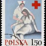 POLAND - CIRCA 1970: A stamp printed in Poland shows medical sister helps the elderly woman, circa 1970 — Stock Photo