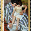 RWANDA - CIRCA 1975: A stamp printed in Rwanda shows the work the bath by Mary Cassatt, circa 1975 — Stock Photo