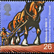 Stock Photo: UNITED KINGDOM - CIRC1999: stamp printed in Great Britain dedicated to Millennium, shows mechanical farming, circ1999